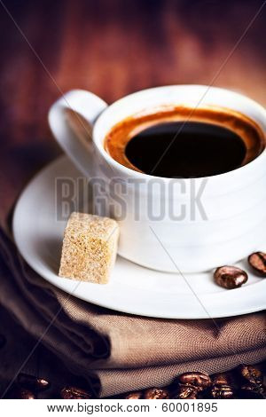 Coffee Cup With White Saucer And Roasted Coffee Beans  On Wooden  Brown Background, Macro. Cup Of Es