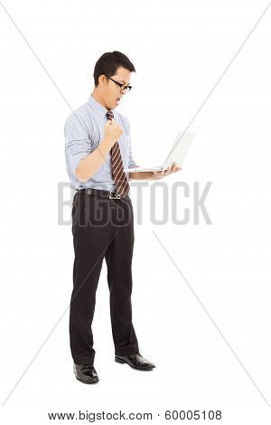 Computer Engineer Is  Standing And Clench His Hand