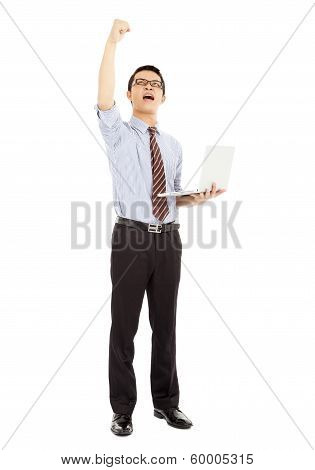 Success Computer Engineer Is  Standing And Raise His Hand