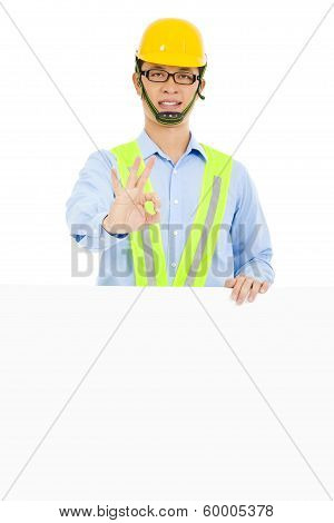 Happy Architect Make Ok Gesture And Holding Board