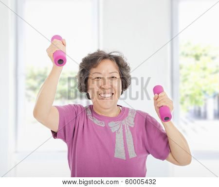 Happy Senior Woman Working Out With Dumbbells