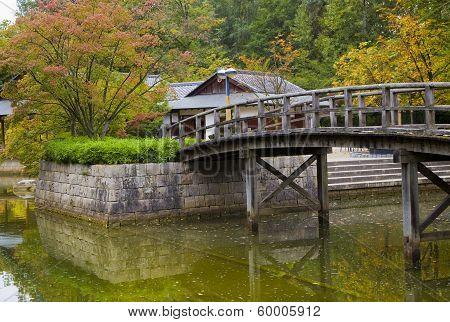 Bridge On Pond In Japanese Garden
