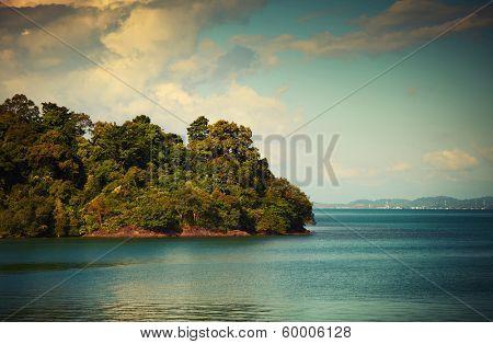 Island with green lush coastline and calm sea. Koh Chang, Thailand