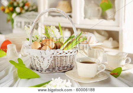 Easter Basket Full Of Eggs On A Festive Table
