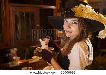Zoomed Woman At Dress With Porcelain Cup
