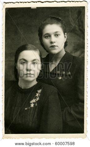 KURSK, USSR - CIRCA 1954: An antique photo shows studio portrait of a two womans.