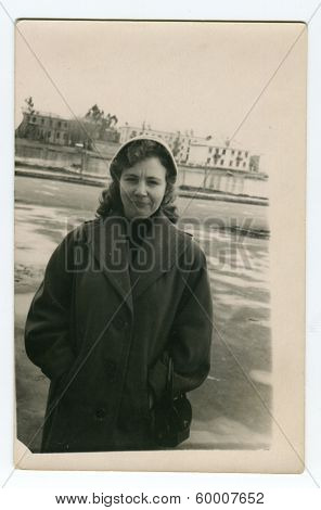 KURSK, USSR - CIRCA 1971: An antique photo shows outdoors portrait of a young woman.