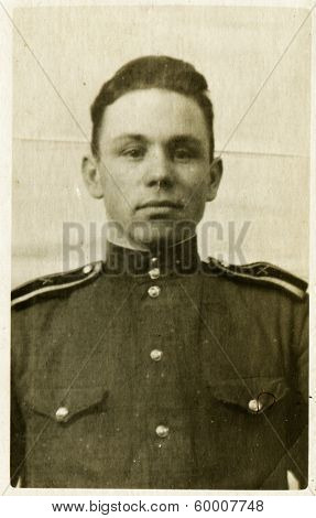 KURSK, USSR - CIRCA 1948: An antique photo shows portrait of a Soviet Army soldiers in uniform.