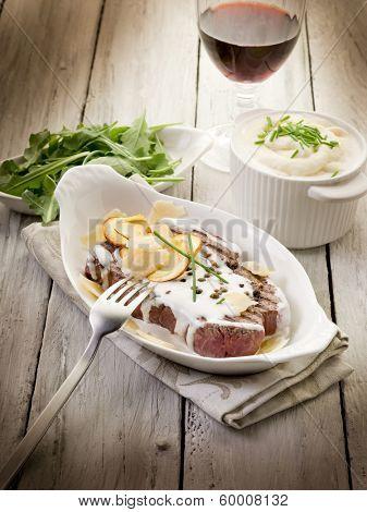 tenderloin with cream sauce ovum mushroom and arugula salad