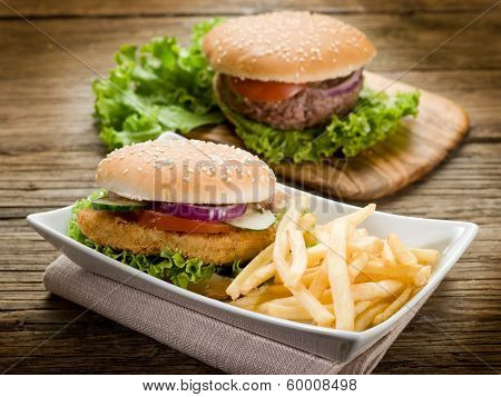 sandwich hamburger with chicken  potatoes and salad