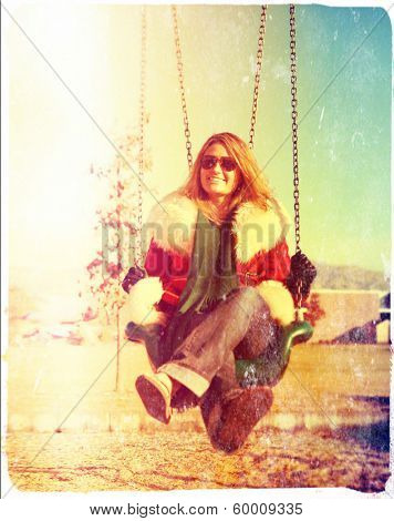 a pretty woman sitting in a swing done with a retro vintage instagram filter