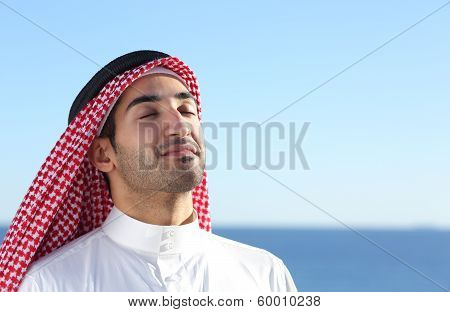 Arab Saudi Man Breathing Deep Fresh Air In The Beach