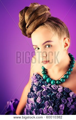 Portrait of a beautiful girl with a festive hairstyle.