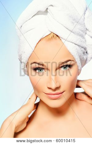Portrait of a happy beautiful blonde woman after bath smiling at camera. Body care.