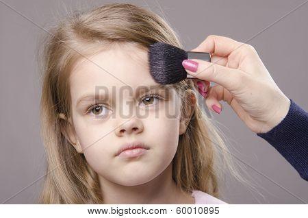 Makeup Artist Deals Powder On Face Of Girl