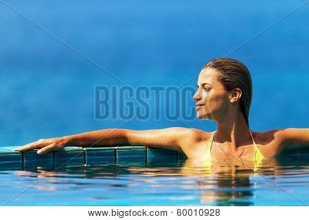Beautiful Natural Portrait Of A Woman Relaxing In A Pool
