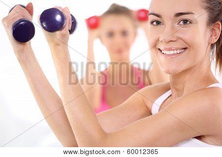 Beautiful women train with weights