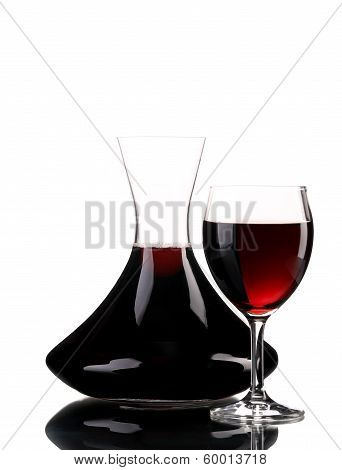 Decanter and glass of wine.