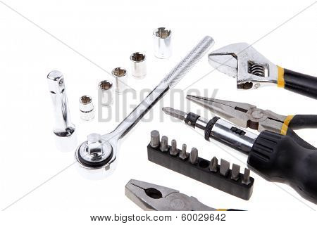 kit of tools include pliers wrench ratche handle bushs and bit driver