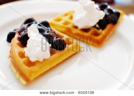 Tasty Looking Waffle With Blueberries And Cream