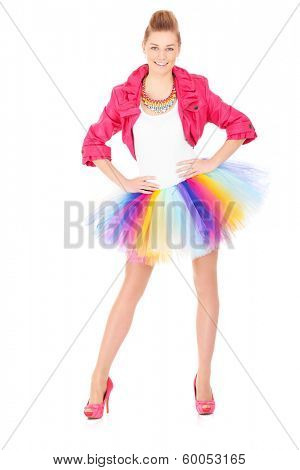 A picture of a happy ballerina dancing in a colorful skirt over white background