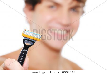 Cheerful Man With Razor On The Foreground