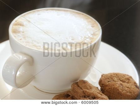 A Cup Of Cappuccino With Chocolate Chip Cookies