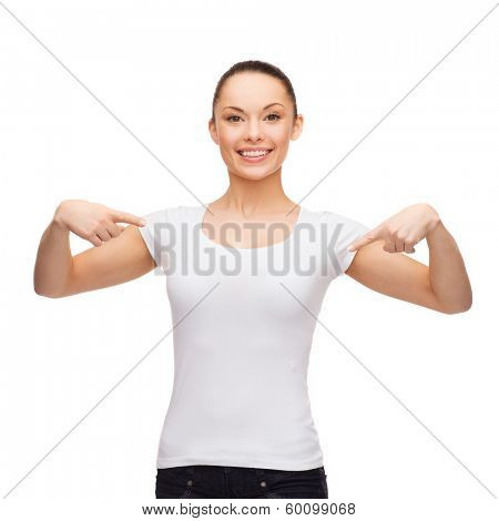 t-shirt design concept - smiling woman in blank white t-shirt pointing at herself