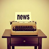 picture of an old typewriter with a page with the word news written in it, with a retro effect poster