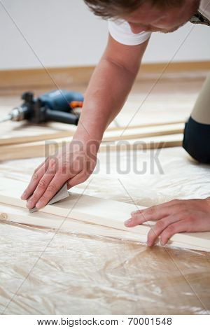 Man Renovating New Apartment