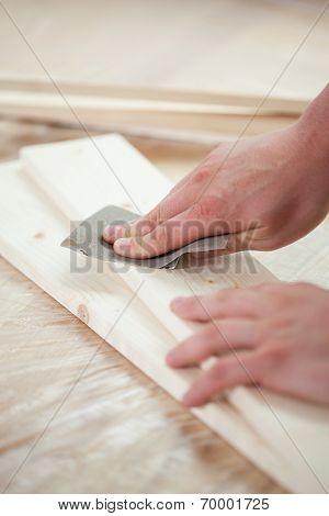 Man's Hands During Renovating Floor