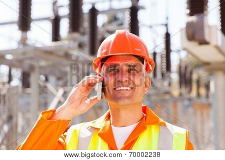 happy senior electrical engineer talking on cell phone