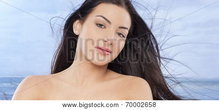Nice woman with long hair on the seaside