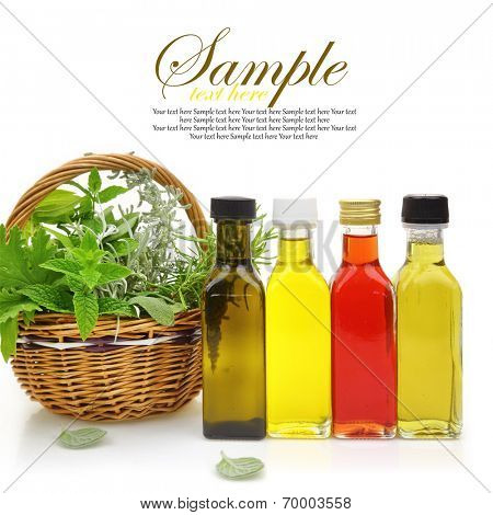 Fresh herbs in wicker basket, essential oils and herbal essences