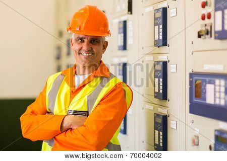 portrait of senior control room engineer with arms crossed