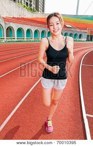 Chinese Woman Jogging At Stadium