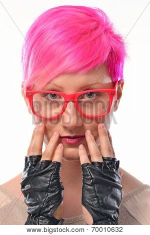 Pink hair woman punk portrait.Punk girl wearing gloves and eyeglasses.
