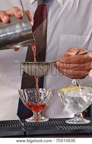 Barman preparing cocktail drink.