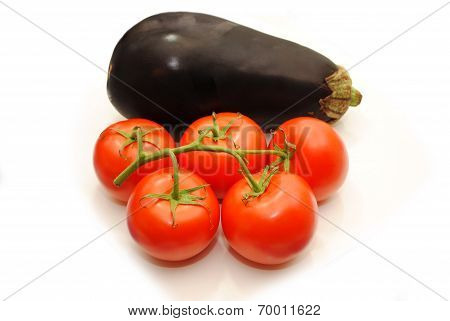 Five Tomatoes On A Vine With A Whole Egplant