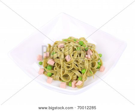 Pasta tagliatelle with green peas and ham.