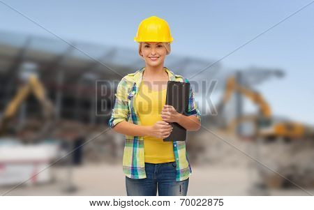 repair, building, construction and maintenance concept - smiling woman in helmet with clipboard