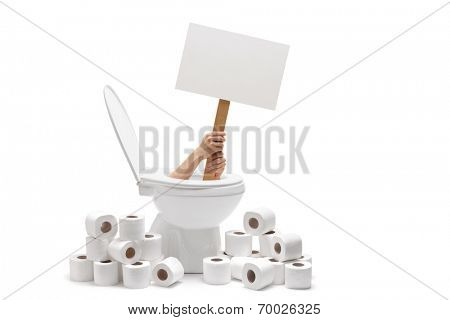 Hands holding a blank banner from a toilet with a pile of toilet paper around isolated on white background