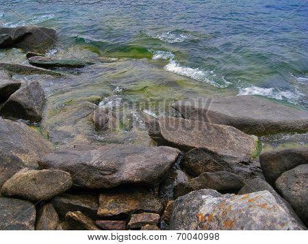 Nature Of Lake Baikal. Rolling Waves On Coastal Rocks