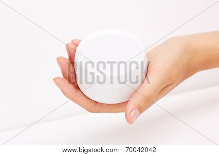 Female hand with a hand cream