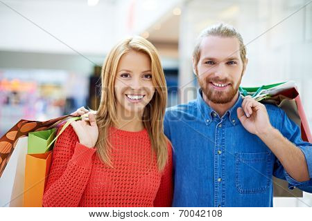 Happy couple with purchases