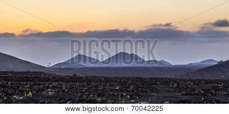 Spectacular Sunset Over The Volcanic Mountains In Lanzarote