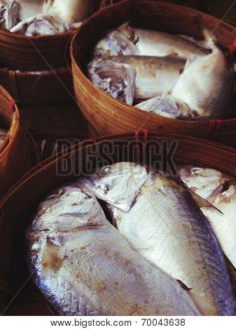 Mackerel fish in bamboo basket