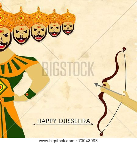 Hands of Lord Rama holding the bow and arrow and taking aim to the half statue of Ravana.