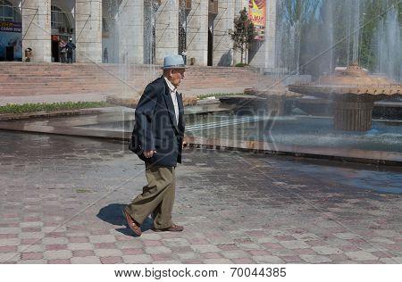 Elderly Asian Man Walking On Ala-too Square