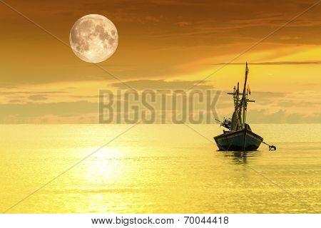 Sailboat and full moon
